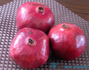 three pomegrantes