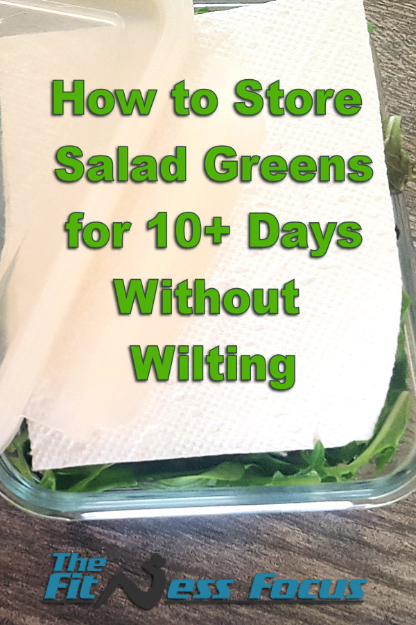 stored salad greens in glass container with paper towel